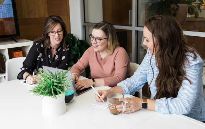 A photo of the Thrive Creative Group team working hard to help business with marketing and SEO.